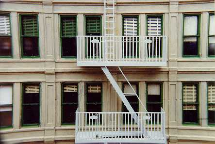 Building with fire escape and venetian blinds