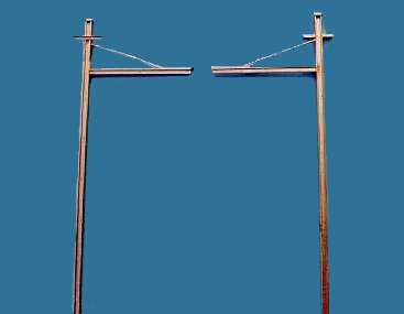 Single catenary poles